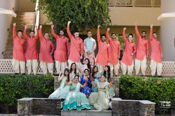 Photo of bride and groom with their bridesmaids and groomsmen on the mehendi