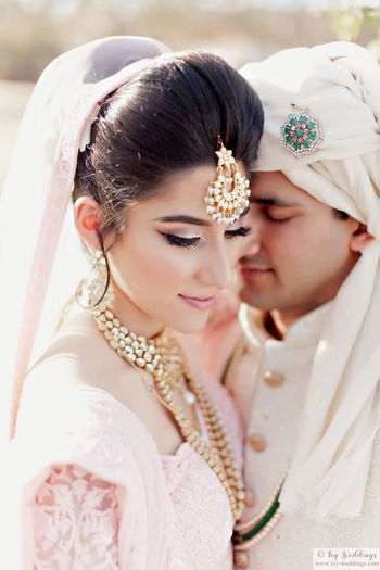 Photo of Poufy bridal bun with dupatta attached