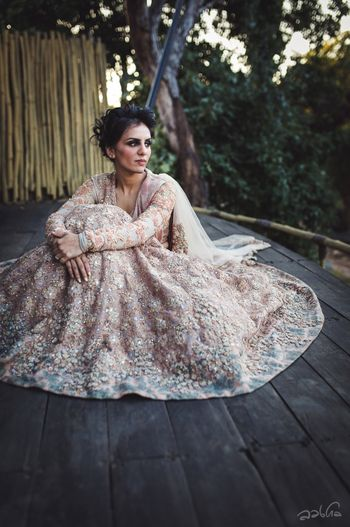 Photo of Bride in blush pink lace Sabyasachi lehenga