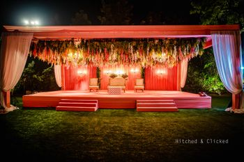 unique jaimala stage with hanging floral decor in peach theme