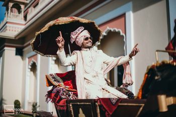 Photo of Dancing groom entering on a chariot.