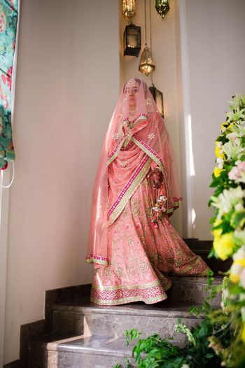 Photo of Sikh bride in pastel pink lehenga