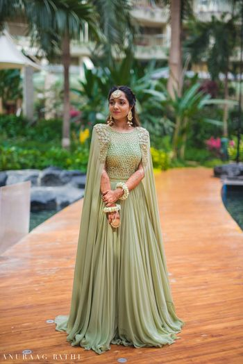 Cape lehenga for engagement in sage green