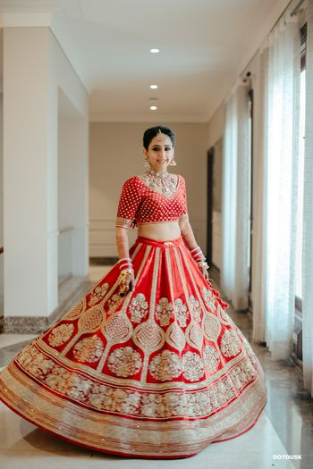 Photo of Twirling bride shot in a Sabyasachi lehenga