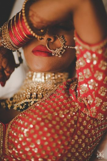 Photo of Unique bridal portrait showing off jewellery