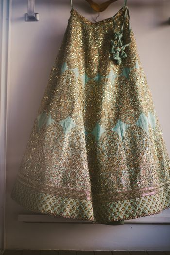 Photo of Light blue lehenga on hanger Sabyasachi
