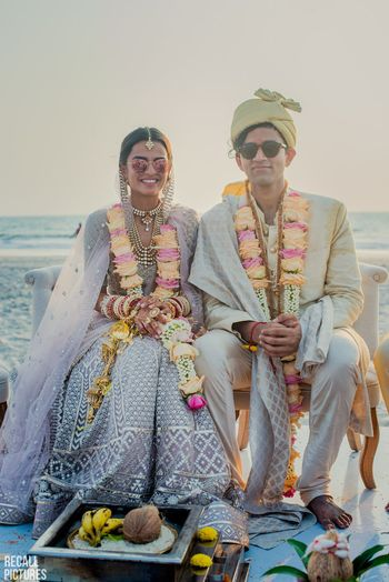 Beach wedding couple portrait with lilac lehenga