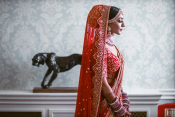 Photo of Bride dressed in a red lehenga.