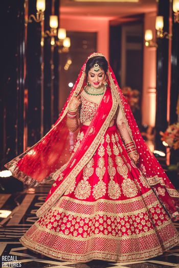 Photo of Red and gold lehenga with big butis