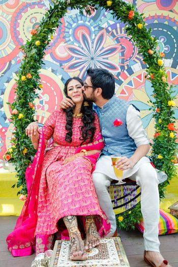 Mehendi swing decor with cute couple portrait