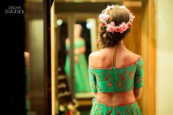 Mehendi hairstyle with floral wreath