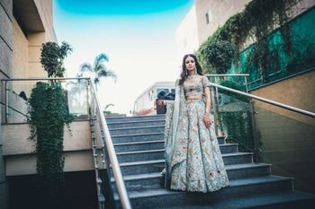 A bride in powder blue lehenga for her mehendi