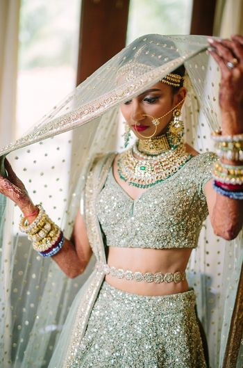 Shimmery bridal lehenga with waist belt