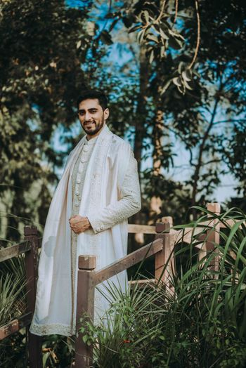 gold and ivory sherwani for a groom for intimate wedding