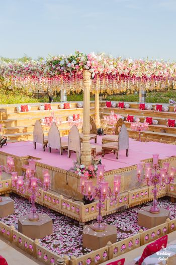 Photo of light pink and gold theme grand mandap with florals