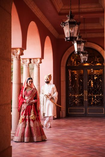Editorial style royal shoot with bride in red sabyasachi lehenga