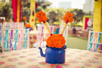Photo of Royal blue kettle with flowers centerpiece