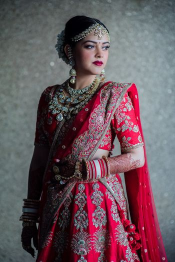 Photo of Bride in red with Abu Jani sandeep Khosla lehenga