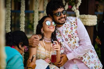 Photo of Mehendi couple shot with both wearing sunglasses