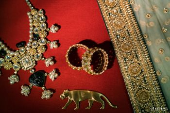 Photo of Bridal getting ready shot idea with accessories and Sabyasachi logo