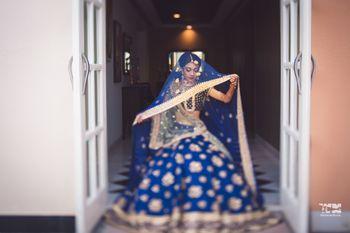 Bridal portrait pose in blue lehenga