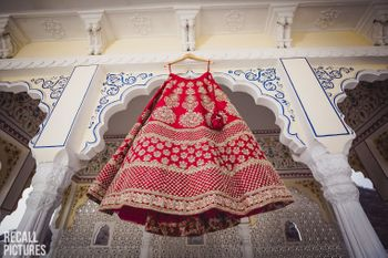 Classic red sabyasachi lehenga on hanger