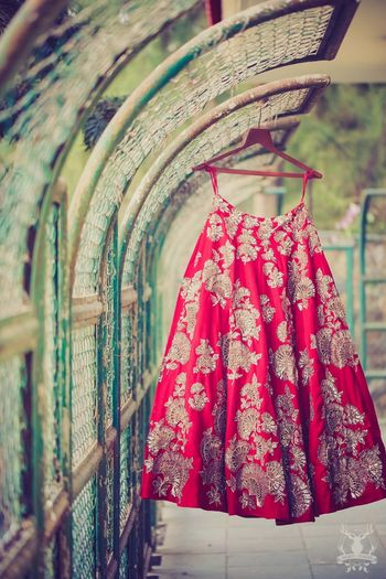 Red and gold bridal lehenga manish malhotra
