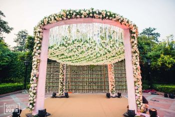 Photo of Circular light pink floral mandap