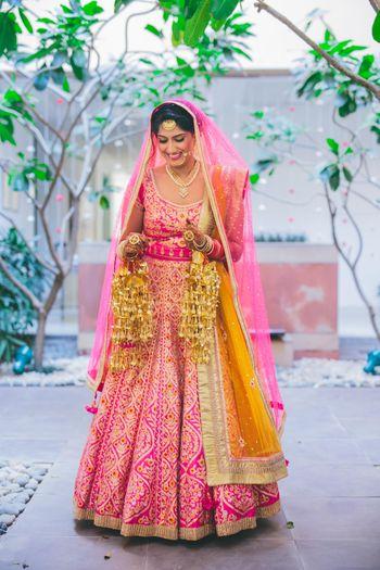 bright pink bridal lehenga by Shyam Narayan Prasad