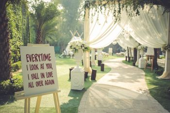 Simple yet stunning drape entrance decor with a signage