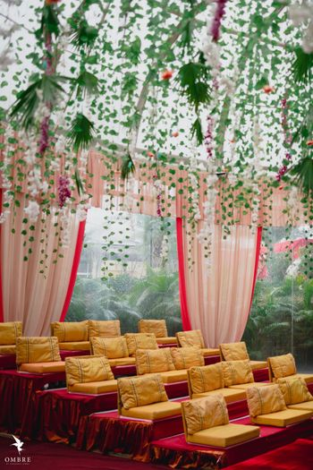 seating arrangement with floral strings around the mandap