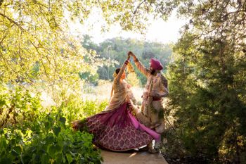 Photo of twirling brides
