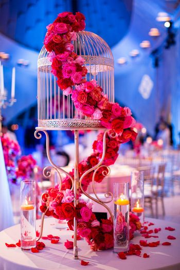 Photo of Bird Cage Candlestand with Floral Arrangement