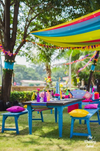 Colourful mehendi seating decor idea