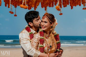 Photo of bright and happy south indian couple shot