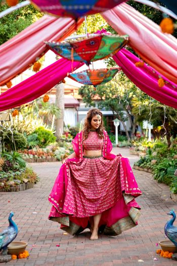 A high-low pink mehendi lehenga