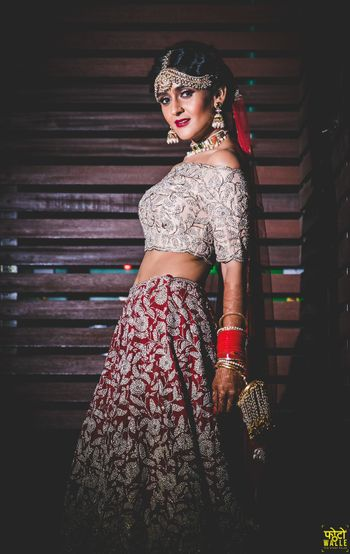 Photo of Modern bridal lehenga in silver and red with off shoulder blouse