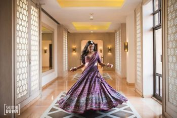 Twirling bride portrait in purple lehenga