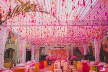 pink mehendi theme with gota tassels hanging from the tent