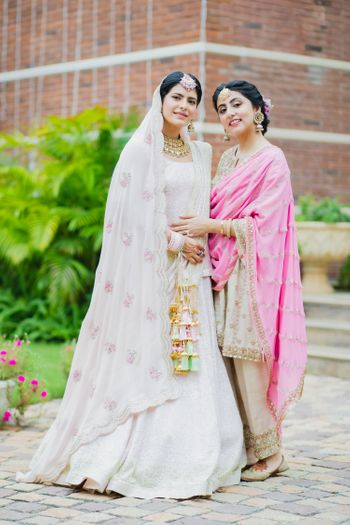 pastel pink sikh bride with her sister before the wedding