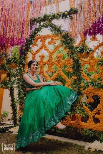 Bride in pretty green outfit for the mehendi