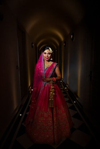 Indian bride wearing hot pink lehenga for wedding