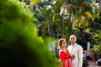 A couple portrait with the bride in red and the groom in white