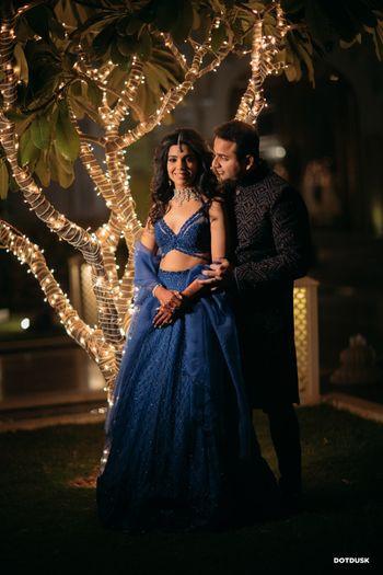 A romantic couple portrait in front of fairy lights decor