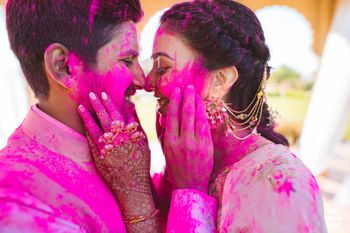 A couple captured on camera during their holi-mehendi party