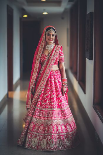 Photo of Red sabsysachi lehenga with multiple borders