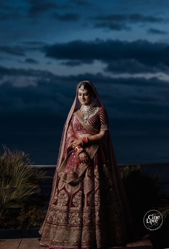 Photo of classic maroon heavy bridal lehenga