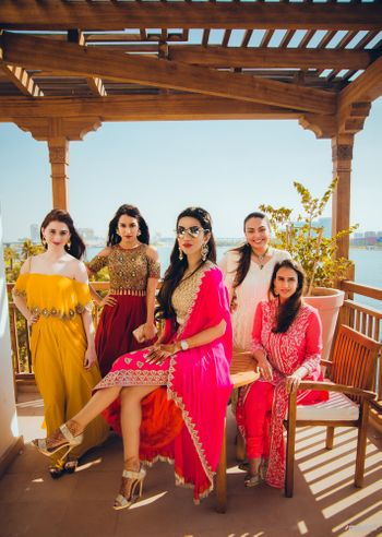 Photo of Bride and bridesmaids photo with swag