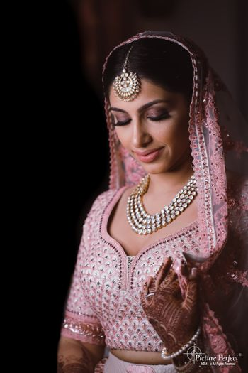 Photo of bridal makeup with pink smokey eyes