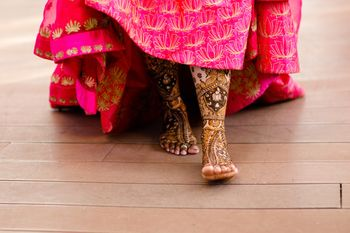 Photo of Bridal feet mehendi design with pink lehenga